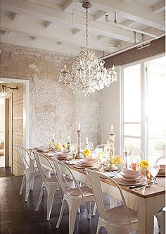 Wonderful white dining room with vintage lamp and tolix chairs