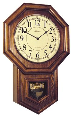 "German Quartz Wooden Wall Clock 860-W by Loricron Clocks features a Classic schoolhouse clock in medium oak finish with:Raised brass bezel, Convex glass, Regulator glass, Polished brass pendulum with wooden rod, Arabic numeralsGerman quartz (battery) movement, 4/4 Westminster Chimes with Bell Strike, Night shut-off switch, Volume control, Fully automatic hour strike Dimensions are 23"" H x 14 1/2"" W x 4"" DLoricron Clock Company was established in 1983 by the Krause family of Cincinnati…"