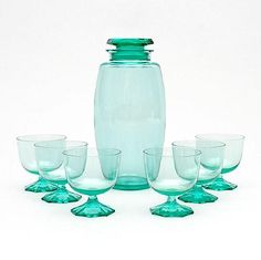 Sea-green glass cocktail shaker with six glasses with facet cut stand, design A.Copier executed by Glasfabriek Leerdam / the Netherlands