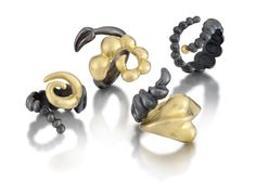 These 18k and oxidized sterling rings are sculptural and comfortable.  www.shanakroiz.com