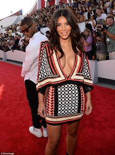 Curvaceous: Kim looked stunning as she wore a plunging Balmain dress to the MTV VMAs on Sunday evening. Cheeky Usher sneaked a peek at her d...