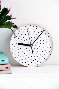 Design Sponge Spotted Clock! Love love love the simplicity and the polka dots. Perfect home office, bathroom, or any room decor!