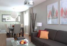 steingraue Wandfarbe, braunes Sofa und farbige Akzente