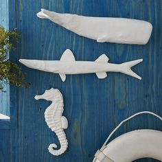 Handmade in Haiti. As part of our collaboration with Port-au-Prince workshop Caribbean Craft, we worked with artisans in Haiti to create these playful sea creatures. Whale, Seahorse + Barracuda are made from recycled materials — they bring a wild side to walls in the most responsible way.