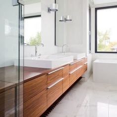 Modern Master Bathroom : Contemporary Bathroom with a Double Sinks by Natural Balance Home Builders. Maple Cabinets in Bathroom Inspiration for a Contemporary Bathroom with a Freestanding Tub
