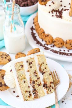 Milk and Cookies Layer Cake - layers of brown sugar vanilla cake with mini chocolate chips, vanilla frosting and crumbled chocolate chip cookies between the layers!