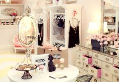 Love the Shabby Chic'ness of this closet. (that needs to be a new word in the Urban Dictionary, if it isn't already;)