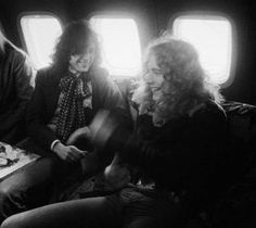 "Jimmy Page and Robert Plant aboard Led Zeppelin's private jet, ""The Starship"""