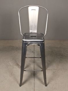 audubon bar stool |redinfred.com  made from powder coated steel, bent masterfully into curves + fluted surfaces, in clusters, the audubons will add shapely sleek texture to any bar space.
