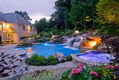 Love the water feature highlighting the natural setting behind it. Great design...add perennials for a bit more color, a stone fireplace, an outdoor kitchen and this would be the perfect backyard retreat.