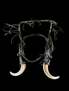 Africa | Headdress from the Mursi people of Ethiopia | Leather, fiber, metal and tusks | ca. 1950
