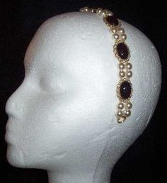 Sapphire & Sage: This beaded and jeweled headband is perfect for making your modern hair look very much in Renaissance-Era style. Made with 8mm imported glass pearls and 18x13mm stone/setting combinations. Choose to have your headband either hand-wired onto a nickel-plated metal-frame headband or free-flowing (as pictured above) with ribbons for tying.