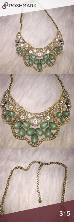 Faux gold statement necklace with rhinestones Faux gold statement necklace with rhinestones and aqu gems. Claw closure. Pairs excellent with aqua New York and Company sweater in my closet Jewelry Necklaces