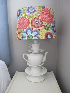 Tutorial for covering lamp shades with fabric.  I really like this lamp.