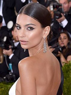 DARK BROWN Dark-brown hair works on just about everyone. The contrast is nice if you're pale, and if you're darker, it just looks natural. Oh, and it looks good with a spray tan, too—as Ratajkowski demonstrated at the Metropolitan Museum of Art's Costume Institute Gala. To get her style, slick it back for added shine.   Photo: Karwai Tang/WireImage