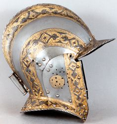 "Desiderius Helmschmid, German, documented 1513–1579, Helmet (Burgonet) from the ""Flower-Pattern Armor,"" c. 1550, etched, embossed, and gilt steel, Patrimonio Nacional, Real Armería, Madrid,"