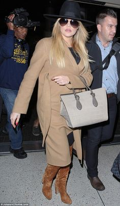 Hatagirl: Khloe rounded off her look with a rather fetching black fedora...