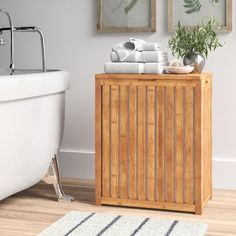 Winston Porter Edward Bamboo Cabinet Laundry Hamper & Reviews | Wayfair Bamboo Cabinets, Square Baskets, Folding Laundry, Contemporary Cabinets, Cabinets For Sale, Laundry Hamper, Seasonal Decor, Picture Frames, Decorative Pillows