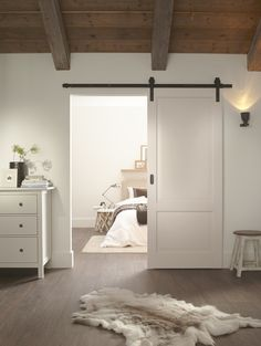 Rustic 80 sliding barn door hardware is ideal for barn conversions, period properties or simply for a unique feature in the home. Suitable for internal doors weighing up to 80kg, the system creates a traditional look for sliding wooden doors with the exposed steel straps fastening down the front of the door to support the rustic finish. The beautifully crafted barn door style hangers run smoothly across the flat bar track.