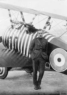 "IWM caption: ""Captain Wilson of No. 28 Squadron RAF by his Sopwith Camel biplane, Florence."" Source: IWM (Q 70787)"