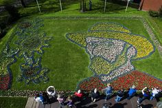 "LISSE.- People look at Tulips planted to form a portrait of Dutch painter Vincent van Gogh at Keukenhof flower garden in Lisse on April 21, 2015. The flower garden's theme is ""Van Gogh"" for the 2015 season, marking the 125th anniversary of his death."
