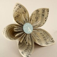 """Make a traditional Japanese decoration using old books via this how-to from """"Playing with Books"""""""