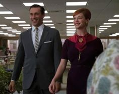 """You could burst into flames and no one would care because Joan (Christina Hendricks) just walked in, wearing a pink and purple dress and swaggin' gold accessories. (""""Babylon"""", Mad Men)"""