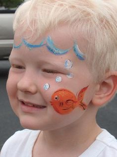 Face painting - Goldfish / fishbowl.  I've seen a similar one with the entire face painted blue, but I like this one - so much simpler.  Love the bubbles.