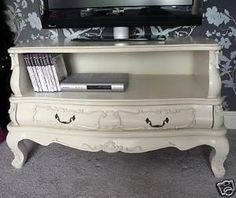 Take out dresser drawers for a vintage TV stand.