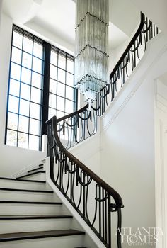 Although the ornate stair railing is original to the house, the elaborate crystal chandelier, which is 26 feet tall and weighs over 2,000 pounds, was a later addition. This chandelier, once displayed in a Manhattan hotel, was purchased in the '80s by previous homeowner A. Stephen Cucich, who installed it in the stair hall. Later removed from the premises, the chandelier was recently procured by the Blanchards, who returned it to its rightful place.