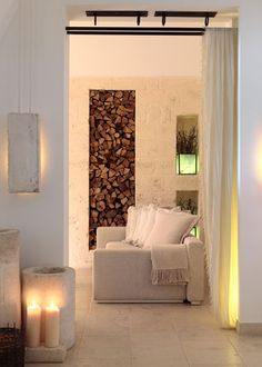 """Great decorating ideas here. Especially love the wood wall detail! This is a perfect place to put Candle Impressions Flameless Pillars in 12"""" on the floor"""