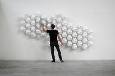HEXI designed by Thibaut Sld., is a responsive wall made from 60 moving modules that allow the shapes to fluctate and mirror a persons movements when they walk past.