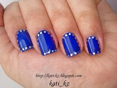 Blue nails with silver edging