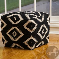 The black and white zig-zag geometric diamond pattern is a classic look and in a unique, new shape. The versatile design works as a pillow seat or ottoman for modern fashion.