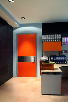 Orange Tekno door in lacquered RAL 2009 by Oikos Venezia.  www.oikos.it