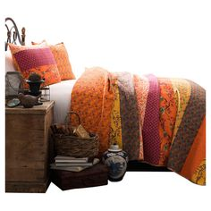 3-piece cotton quilt set with multicolor floral striping.  Product: Full/Queen: 1 Quilt and 2 standard shamsKin...