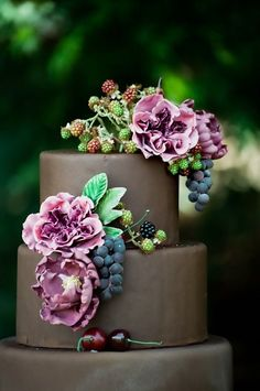 Chocolate Wedding Cake with Purple Sugar Flowers and Summer Berries   Heather Mayer Photography on @loveincmag via @aislesociety