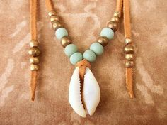 Cowrie Shell Necklace Tribal Necklace - Boho Jewelry Bohemian Jewelry Ethnic Jewelry Tribal Jewelry - Suede Leather Necklace. $24.00, via Etsy.