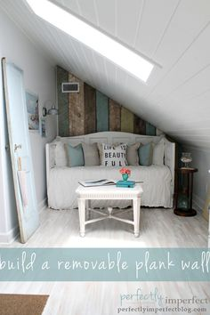 removable plank wall by Perfectly Imperfect (this would be such a cute & useful way to use up that under stair space!)
