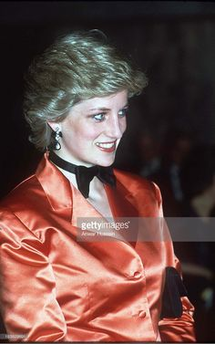 Diana, Princess of Wales wears an orange jacket and a black bow tie during an official visit to Lisbon on February 04, 1987 in Lisbon, Portugal.