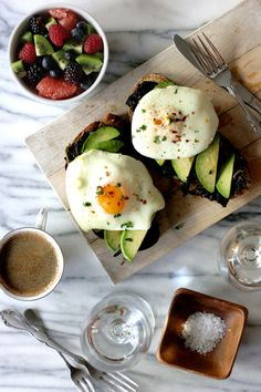 Olive oil poached eggs on avocado toast.