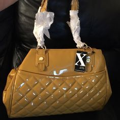 CLOSET OPEN! Maxx New York Patent Leather Purse ❤️❤️PRICED TO SELL❤️❤️ Beautifully quilted mustard yellow purse by www.maxxnewyork.com  ... More room than you can imagine with Cheetah satin lining. Maxx New York Bags