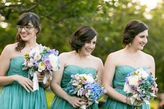 Aqua bridesmaid dresses with blue and purple bouquets // Photographer: Sarah Tew Photography // see more: http://theeverylastdetail.com/2013/09/04/modern-romantic-lavender-blue-wedding/