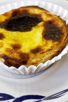 Pasteis de nata is egg custard in a flakey crust.  It's a famous Portuguese pastry.  An awesome Portuguese bakery café is Pao da Terra at 135 Ferry Street in the Ironbound district of Newark, NJ.  The Ironbound is a great place for Portuguese, Brazilian, and Spanish restaurants, bakeries, and supermarkets. Just double click on the image to pop over to an article with more info!