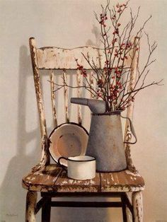 Chippy kitchen chair with tin metal pitcher,  cup and bowl with dried branches makes a perfect country picture.  By  graceful vines