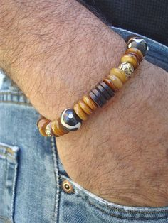 Men's Bracelet with Amber Shell Hand Carved and by tocijewelry, $38.00