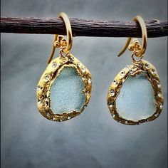 New blue Druzy pave earrings 24k gold leaf Absolutely gorgeous earrings raw Druzy, organic formed with 24k gold leaf and Swarovski crystals. I love organic formed pieces and these are one of my signature pieces. It's versatile and will work with anything. Hooks are 24k gold over sterling silver. Size is about 1.15 inch total. Matana Jewelry Earrings