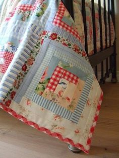 blue and red log cabin quilt--love these fabrics together; definitely has a vintage look which I love.