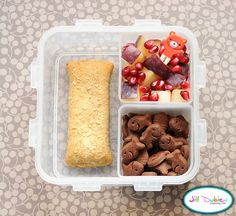 meet the dubiens    This was a really simple bento I made for her morning nutrition break. She had a cereal bar, a container of chocolate graham goldfish and a container of plum and pomegranate seeds with a cute little bear pick.