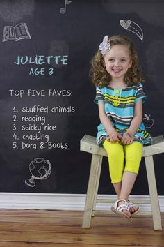 Cute idea for pre-schooler portrait.  She's also wearing a great outfit--nice color palette and a simple print.